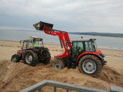 Tractor stuck in the sand.