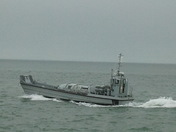 Landing craft choppy seas yacht aground.