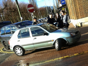 Car loses wheel in town centre