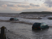 Two more cars caught by the tide.