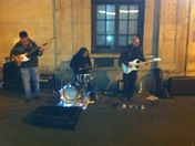 Live. Band outside Holbein tube. Kicking it! Komi hendrix guitar