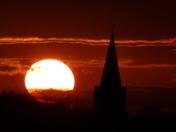 Sunset over Earsham church