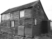 Shed on the shore black and white