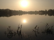 Sunrise over hinchingbrooke lake