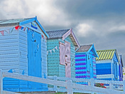 Beach huts, coloured frontages taken at Westward Ho , Verity at Ilfracombe