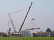 Crane lifting the railway bridge beams for NDR