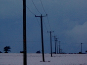 Telegraph Poles march towards the skyline