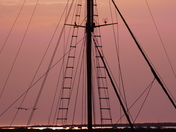 SILHOUETTE. Mast In Front Of Sunset