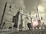 Church guarded by graves