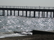 Pier with a sparkling sea