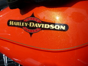 ORANGE. On Harley Davidson Bike