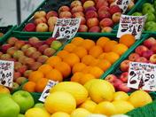 ORANGE. Market Stall Selling Oranges