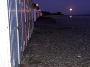 Beach huts by moolight