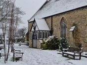 Snow falling at St. Peter's Church Aldborough Hatch