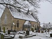 Snow falling at St. Peter's Church Aldborough Hatch