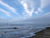 Waves, clouds and blue sky at Sea Palling