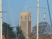 Woodbridge church through ship's masts