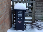 Wheely bin with snow hat