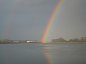 A Rainbow and its Reflection On The River Deben