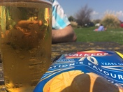 A beer and a bag of crisps