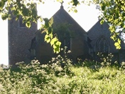 Contrasts of light and dark across the churchyard