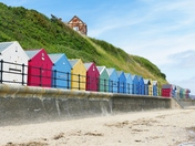 COLOURFUL BEACH HUTS AT MUNDESLEY