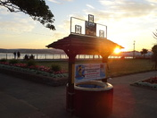 "Sunset over the sea - The Wishing Well, opposite the ""Ocean Bowl & Grill"""