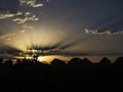 Crepuscular rays (sunbeams) over Harleston at dawn
