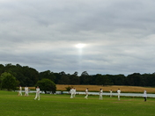 BEAM OF LIGHT AT THE END OF A CRICKETING DAY AT HOLKHAM HALL