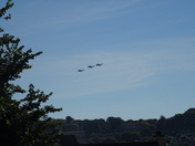 Three Helicopters flying over in the sky