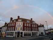 "A pink rainbow over ""Prezzo"""