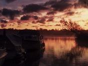 Sunrise over malthouse Broad