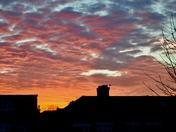 Brilliant sunrise over rooftops in Aldborough Hatch