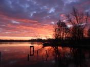 Winter sunrise over malthouse broad