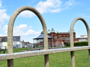 Views Of Gorleston Pavilion Theatre And Gorleston Band Stand Through the Fence