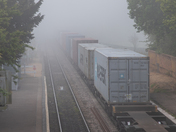 Freight train in the mist