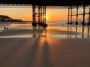 Cromer sunset under the pier