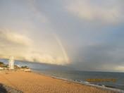A rainbow seen over the beach