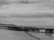 Happisburgh beach and lighthouse in black and white