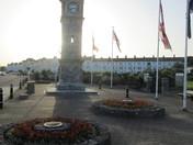 Sun behind the clock tower