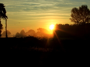 Sun rising over Waldringfield Golf Club