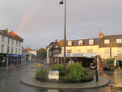 Sunny & showery weather forming rainbows