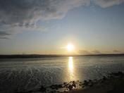Sun sets over the estuary.
