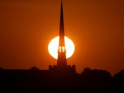 The sun and Stowmarket church spire.