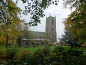 Fakenham church through the autumn trees