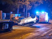 Upturned car closes road