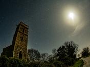 Panxworth Church ruin lit by moonlight