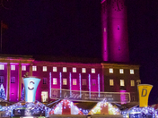 Norwich City Hall lit up behind Britains Best Large Outdoor Market 2019