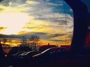 Sunset over blue boar  at tescos