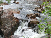 Water tumbling over the boulders. (Challenge)